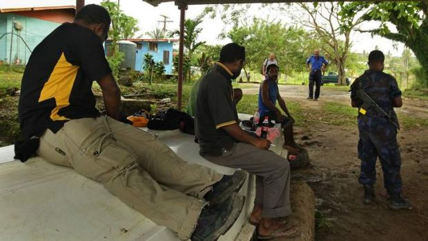 Papua New Guinea police mobile squad hired to secure the Australian-run detention centre on Manus Island.