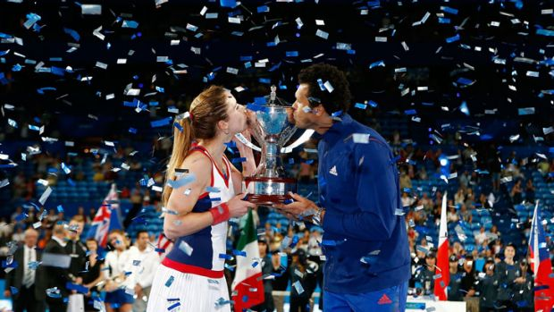 Alize Cornet and Jo-Wilfried Tsonga of France hold the Hopman Cup after defeating Grzegorz Panfil and Agnieszka ...