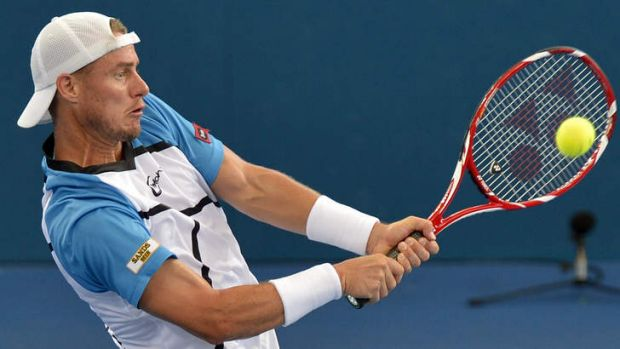Lleyton Hewitt plays a backhand against Roger Federer.