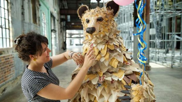 Blending elements of theatre with contemporary art: Costume designer Clare Britton adds touches to the giant bear puppet.