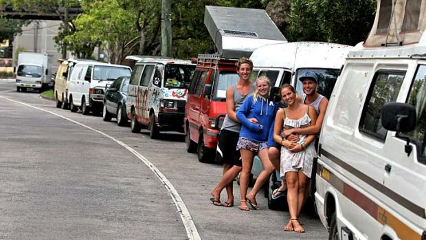 Fancied spot: German backpackers and their vans at Wentworth Park.