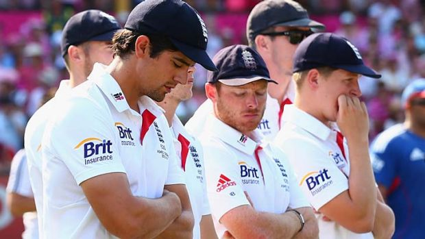 Under scrutiny: Captain Alastair Cook and members of the English side look dejected during day three of the fifth Ashes Test.