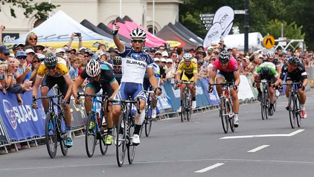 Pumped: Brenton Jones crosses the finish line to win the Bay Cycling Classic at Williamstown.