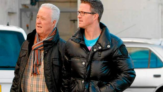 Michael Schumacher's father Rolf, left, and brother Ralf arrive at Grenoble Hospital.