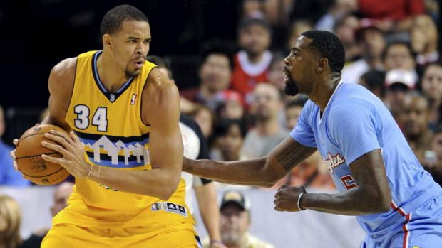 Denver Nuggets centre JaVale McGee is guarded by LA Clippers rival DeAndre Jordan during the preseason.