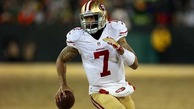 Colin Kaepernick runs the ball for a first down in the fourth quarter.