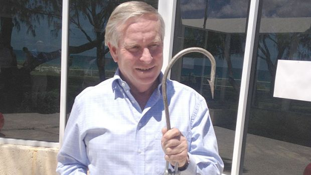 Premier Colin Barnett with one of the hooks used to catch sharks.