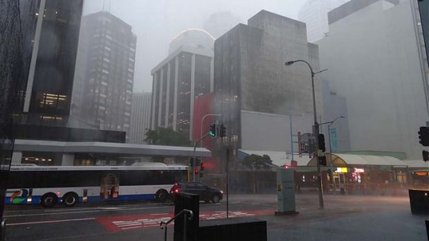 Heavy rain hits the Brisbane CBD.
