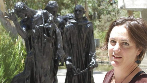 National Gallery of Australia curator Lucina Ward with castings of figures from Rodin's <em>The Burghers of Calais</em>.