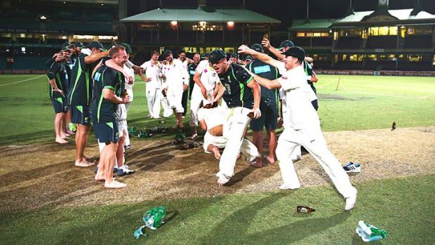 Cheers mate: Chris Rogers pours beer on David Warner while the players celebrate the 5-0 Ashes whitewash.