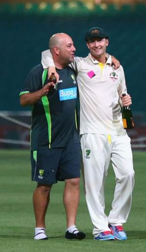 Feeling bubbly: Australian coach Darren Lehmann and skipper Michael Clarke share a midnight champagne moment at the SCG.