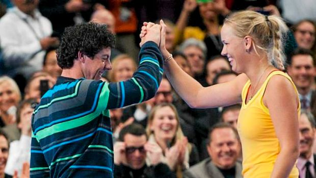 Perfect match: Golfer Rory McIlroy with fiancee, tennis player Caroline Wozniacki.