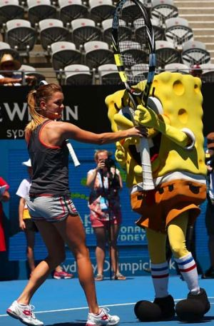 Agnieszka Radwanska takes place in Kids Day activity on day two of the Sydney International on Monday.