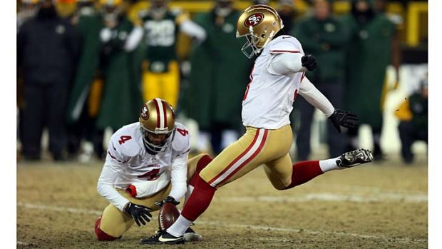 Phil Dawson of the San Francisco 49ers kicks a field goal to defeat the Green Bay Packers.