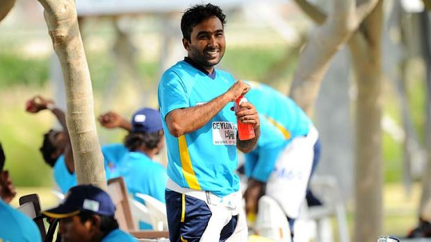 Mahela Jayawardene has a drink during a break in practice at the Dubai Sports City on Monday. The second Test against ...