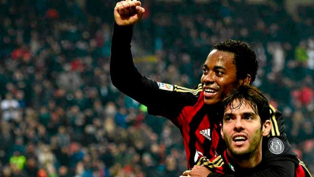 Kaka celebrates after scoring a goal for AC Milan with fellow Brazilian Robinho (top).