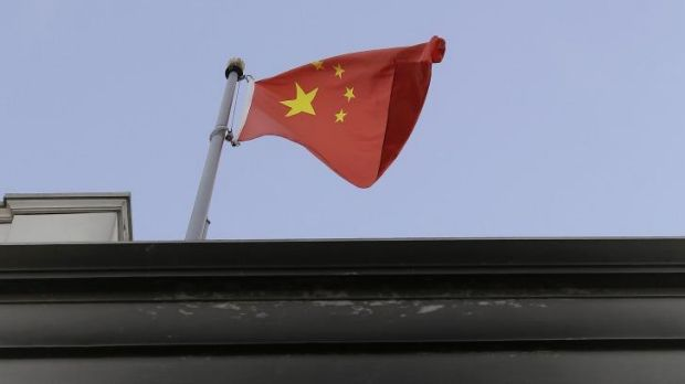 The flag of China flies over the damaged entrance of the Chinese Consulate in San Francisco.