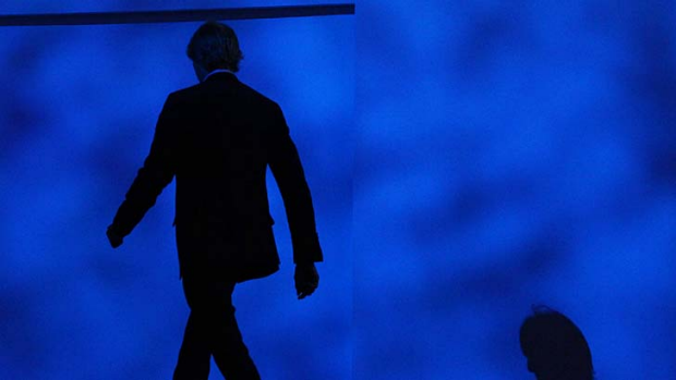 Director Michael Bay leaves the stage during a Samsung conference at CES.