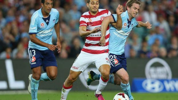 It's on again: Adam D'Apuzzo of the Wanderers and Sydney FC's Matt Thompson lock horns during the most recent Sydney ...