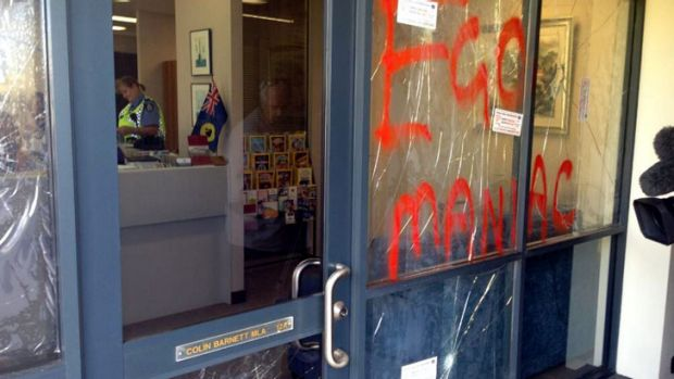 """Egomaniac""  was daubed in red across the office windows."