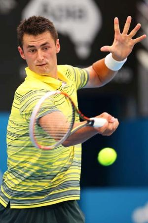 Eye on the ball: Bernard Tomic smashes a forehand.