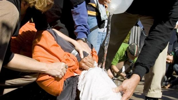 Interrogation method: Protesters demonstrate the use of waterboarding.