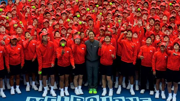 Chinese player Li Na poses with the Australian Open squad of 380 ball kids on Tuesday.