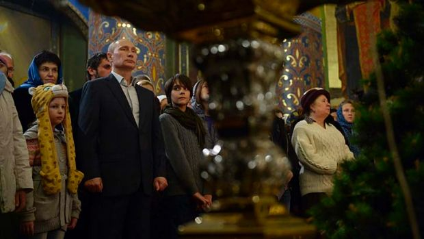 Russian President Vladimir Putin attends the Orthodox Christmas service at the Holy Face of Christ the Saviour Church in ...