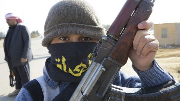 A boy holds his Kalashnikov rifle in Ramadi. Iraq's PM urged people in the besieged city of Falluja on Monday to drive ...