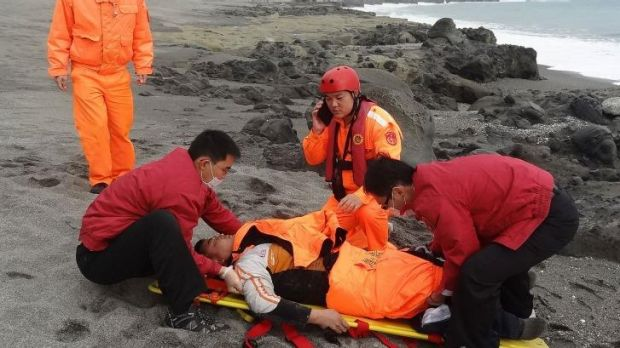 Tseng Lien-fa receiving treatment on the beach in Taitung county, southeast Taiwan.