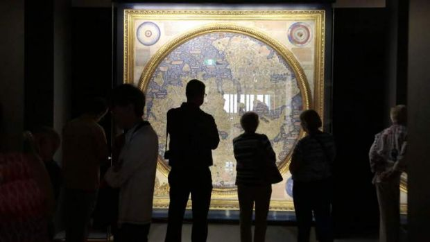 Visitors take a look at the map of the world 1448-1453 by Fra Mauro.