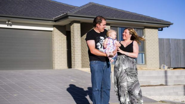 James Petterson, with his wife Sarah, and 16-month-old daughter Rachael, outside their home in Bonner.