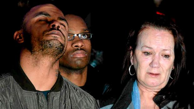 Pam Duggan (right), and Marlon Duggan (left), Mark Duggan's mother and brother, react after the verdict.