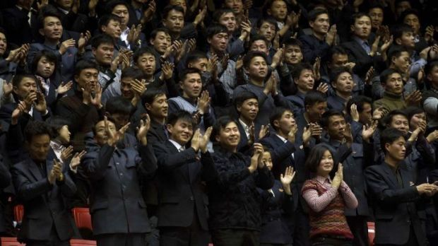 North Koreans cheer during an exhibition basketball game between US and North Korean players at an indoor stadium in ...
