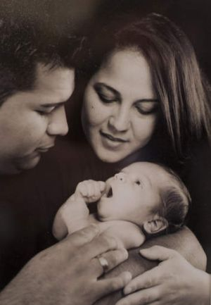 Marlise Munoz, her husband, Erick Munoz, and their son, Mateo, at 3 weeks old.