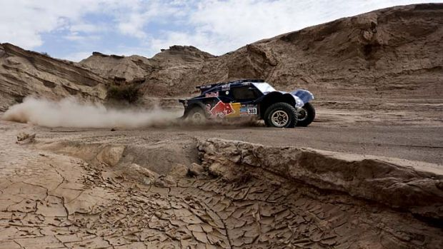 Carlos Sainz and co-driver Timo Gottschalk compete during the fourth stage of the Dakar Rally.