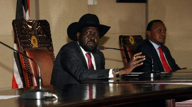 South Sudanese President Salva Kiir, left,  with his Kenyan counterpart Uhuru Kenyatta during peace talks on Boxing Day ...