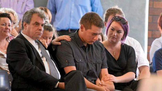 John Cremin (second from right), Yvanna's half brother, sits with family at the memorial service in Caloundra.