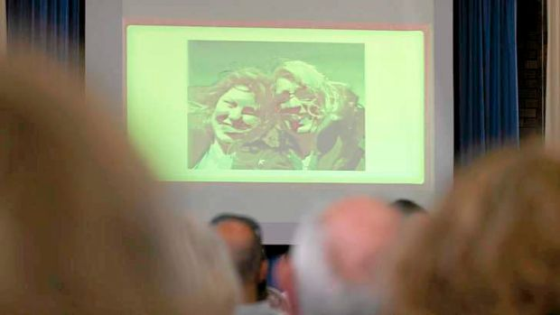 Images of Noelene and Yvana Bischoff are shown during a memorial service for the mother and daughter.