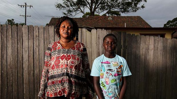 Home safe: Asunta Manok and her son Makuei, 10, after being evacuated (above); John Mac Acuek and his son