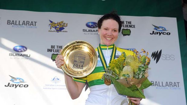Reason to celebrate: Sarah Roy with the trophy for her first national championship in the women's criterium at Ballarat. ...