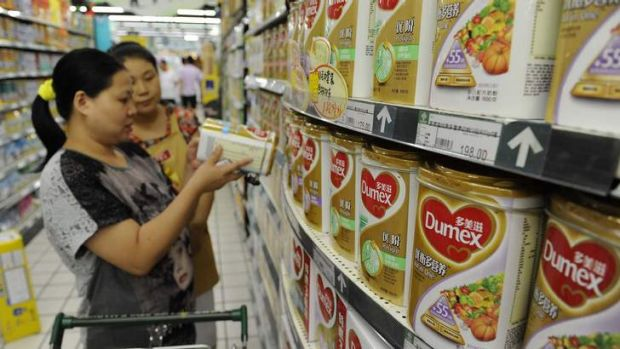 Shoppers in China study milk powder labels after the Fonterra scare came to light last year.