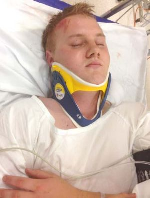 Latest victim: Alexander McEwen lies in hospital with a fractured skull.
