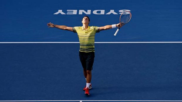 Local hero: Bernard Tomic celebrates his victory over Sergiy Stakhovsky on Friday.