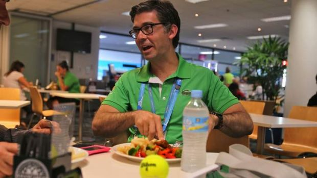 Ready to serve: Darren Sturgess tucks in at the media restaurant at the Rod Laver Arena. ''I actually don't get to see ...