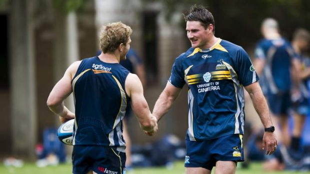 David Pocock greets Ben Mowen at Brumbies training on Thursday.