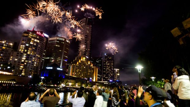 Revellers watch New Year's Eve fireworks at Southbank.
