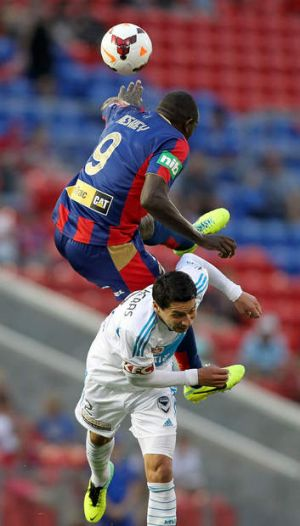 Double act: Newcastle's Emile Heskey heads over Pablo Contreras.