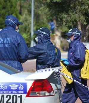 Forensic police arrive at the death scene in Lyndon Boulevard.