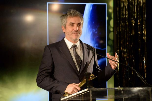 Director Alfonso Cuaron accepts the Best Film Award and Best Direction Award.